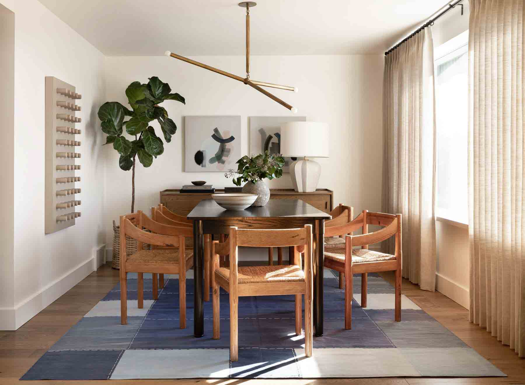 Hardwood Floor in Dining Room with Blue Area Rug